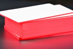 Thick white cotton paper business card mock up with red painted edges. Blank business cards template. Royalty Free Stock Photography