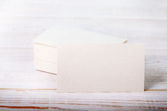 Thick white cotton paper business card mock up on vintage wooden deck Stock Photography