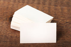 Thick white cotton paper business card mock up on vintage wooden deck Royalty Free Stock Image