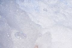 Thick white foam from a bubble machine royalty free stock photo