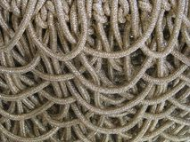 Thick white gold intertwined close up rope designer background Royalty Free Stock Photos