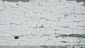 Thick white peeling cracked paint with green underneath Royalty Free Stock Photos