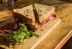 Thick wholemeal bread bacon sandwich Stock Photo