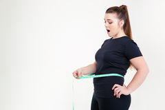 Thick woman measuring her waist Royalty Free Stock Photos