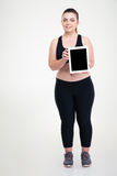 Thick woman showing blank tablet computer screen Stock Photo