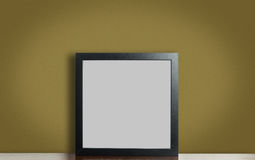 Thick wooden frame on brown. stock photography