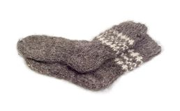 Thick wool hand-knitted socks on a white background. Pair of the thick gray wool hand-knitted socks on a white background Stock Image