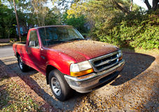 Thick Yellow Pollen on Red Truck, Spring 2012 Royalty Free Stock Images