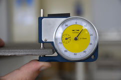 Thickness meter. Measuring the thickness of ceramic tiles Stock Images