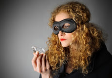Thief. Attractive female thief stealing a diamond royalty free stock images