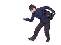 Thief. The walking thief with hand torch stock photography