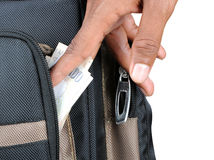 Thief. A hand taking money out of someones bag Stock Image