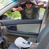 Thief. The thief hijacks a bag and phone from salon cars royalty free stock photo