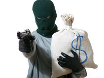 Thief. An image of a man in mask with gun and bag Stock Image
