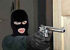 Thief. A snow masked thief holding a revolver through the door Stock Photography