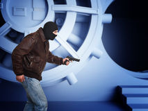Thief in action. Armed thief and bank  vault door 3d detail Royalty Free Stock Image