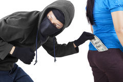 Thief in action to stole money Royalty Free Stock Images