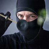Thief in action Stock Photography