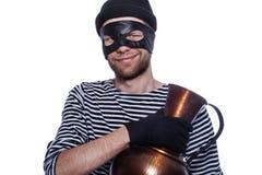 Thief with antique vase. Happy thief with antique vase royalty free stock photos