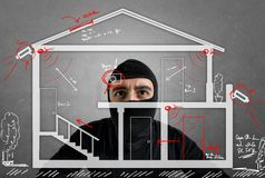 Thief apartment. Studying security system of a new house Royalty Free Stock Images