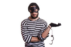 Thief arrested as a consequence of his crime. Portrait isolated on white background Stock Photo