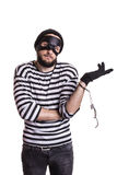 Thief arrested as a consequence of his crime. Portrait isolated on white background Stock Photography