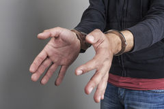 Thief arrested. And waring handcuffs on his hands Stock Images