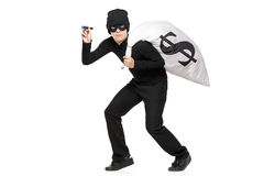 Thief with a bag and flashlight in hands. Isolated against white background Royalty Free Stock Photo