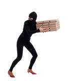 Thief in balaclava with boxes Stock Images