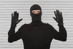 Thief with balaclava Stock Images