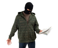 Thief in balaclava with map Stock Photos
