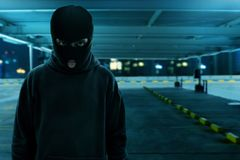 Thief in balaclava at night. Thief in balaclava standing at night Royalty Free Stock Photography
