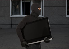 Thief with balaclava Royalty Free Stock Image