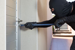 Thief with a bar of iron Royalty Free Stock Images