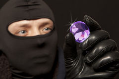 Thief with a big diamond Stock Photos