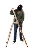 Thief in black balaclava with ladder Royalty Free Stock Photo