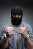 Thief in black mask Royalty Free Stock Photo