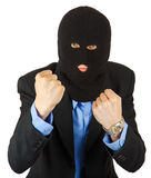 Thief in black mask in suit holding his fists stock images