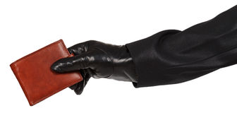 Thief in black suit holding a brown leather purse Stock Image