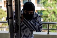 Thief break condo balcony door royalty free stock images