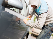 Thief breaking the car lock Royalty Free Stock Images