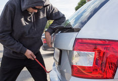 Thief breaking car Stock Image