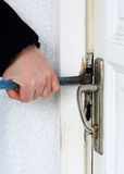 Thief breaking into a house. Housebreaker Royalty Free Stock Image