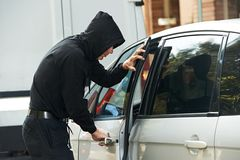 Thief burglar at automobile car stealing Royalty Free Stock Images