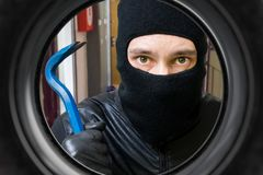 Thief or burglar behind door. View from peephole Royalty Free Stock Photos