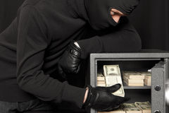 Thief burglar and home safe Stock Photos