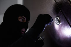 Thief burglar at house breaking Stock Images