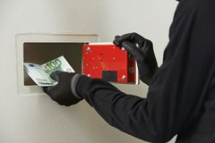 Thief burglar at house safe breaking Stock Photo