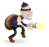 Thief or burglar. An illustration of a thief or burglar cartoon character with torch and sack Stock Photos