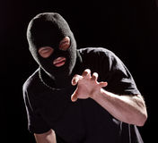 Thief Burglar in Mask Grabbing by Hand. Crime Man in Black Royalty Free Stock Photography